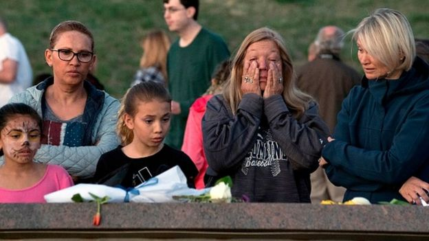 People gather to remember loved ones at the Columbine Memorial