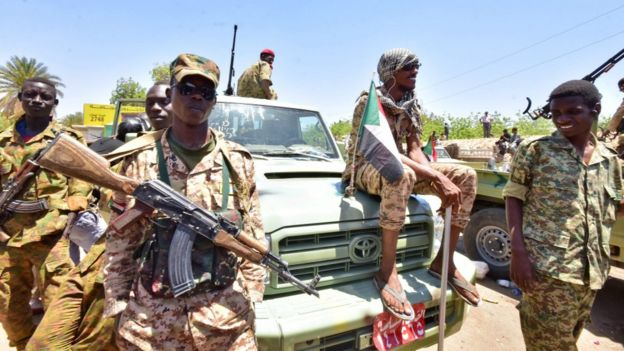 Sudanese armed forces gather near the site of a demonstration close to military headquarters in the capital Khartoum on April 15, 2019