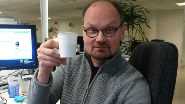 Niilo Simojoki drinking a coffee in his office in Helsinki, Finland