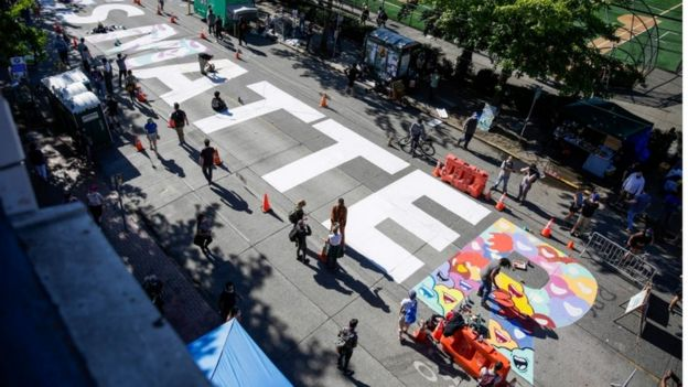 The words 'Black Lives Matter' are painted in the middle of East Pine Street in the Chaz