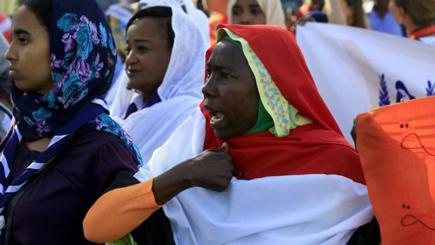 Sudanese woman chanting during a march in Khartoum marking International Day for Eliminating Violence Against Women