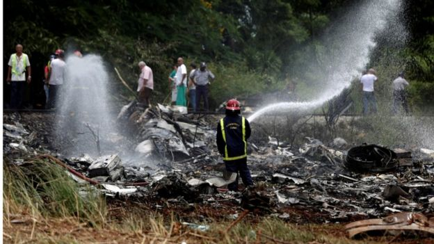 Firefighter and wreckage of the Boeing-737 that crashed shortly after take off from Jose Marti International Airport in Havana, Cuba, 18 May 2018