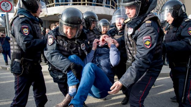 A protester is held by police during an anti-corruption rally in Moscow in March 2016.
