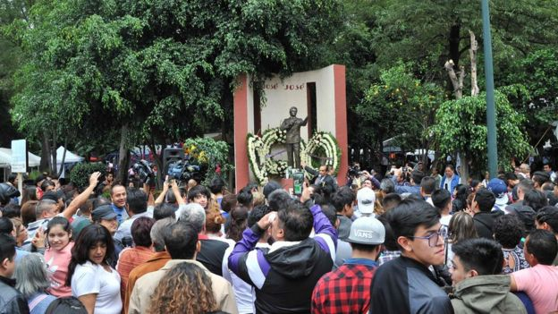 Fans pay tribute to José José in front of his monument in Mexico City