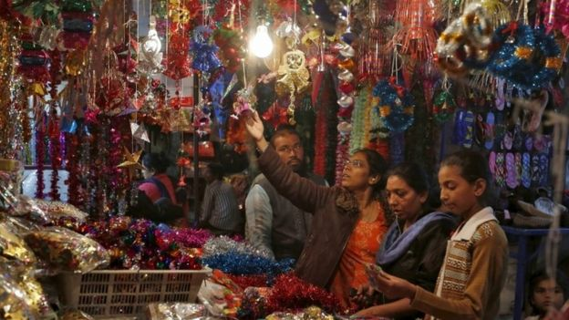 women shop for christmas decorations at a roadside market in ahmedabad india