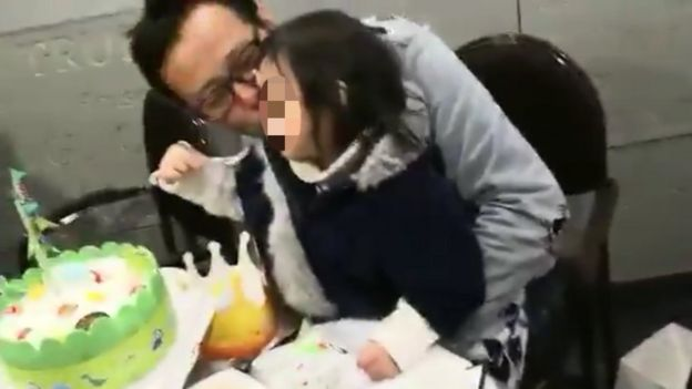 Picture of freed Chinese artist Hua Yong and his daughter