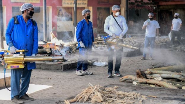 Volunteers spray disinfectant at the Shivpuri Hindu cremation ground during a government-imposed nationwide lockdown as a preventive measure against the COVID-19 coronavirus, in Amritsar on April 11, 2020.