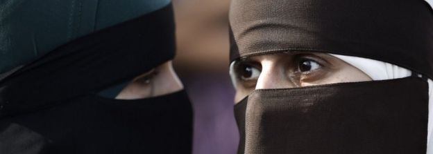 Two women wear niqabs at protest