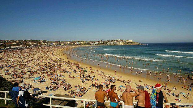 Bondi Beach, Sydney, packed with sun bathers on a sunny day