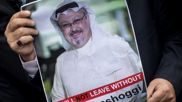 A man holds a poster of Saudi journalist Jamal Khashoggi during a protest outside the Saudi consulate in Istanbul, 8 October 2018