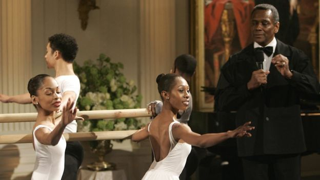 Arthur Mitchell (R) introduces his dancers during the entertainment in honour of the Dance Theatre of Harlem and at the White House in Washington DC, 6 February 2006