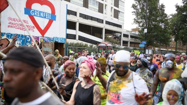 Paint covered revellers at Notting Hill carnival