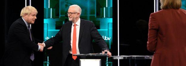 Boris Johnson and Jeremy Corbyn shaking hands