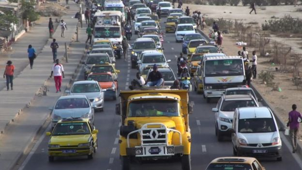 A road with traffic in Dakar, Senegal