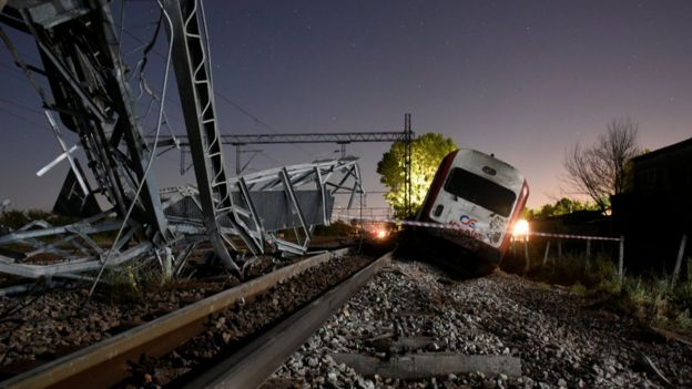 A derailed train carriage is seen toppled in the town of Adendro in northern Greece, 13 May 2017