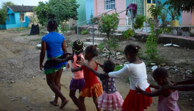A group of children dance through Palenque
