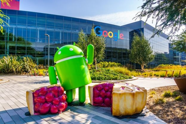 Sculptures of an Android and a cherry pie at at the entrance of Googleplex, Google's HQ in the south San Francisco bay area