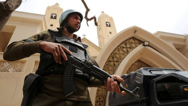 Egyptian armed policeman secures a Coptic church that was bombed in Tanta, Egypt (10 April 2017)