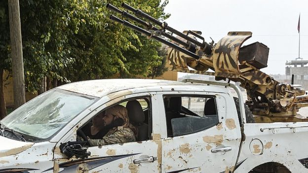 Vehicles carrying the members of Turkish-backed Free Syrian Army drive near the border on October 19, 2019 in Akcakale, Turkey