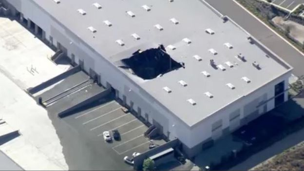 A hole in the warehouse roof was filmed by news helicopters