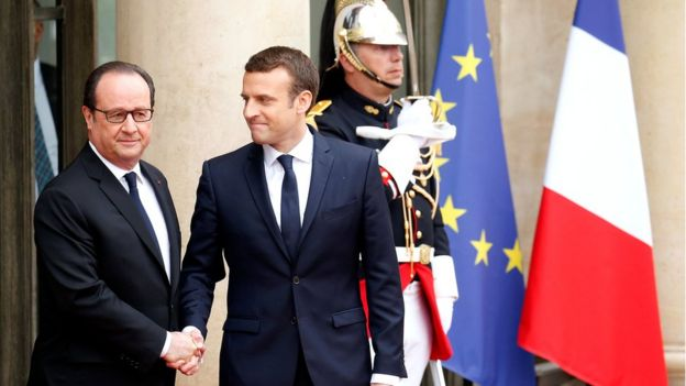 Outgoing French President Francois Hollande greets President-elect Emmanuel Macron who arrives to attend the handover ceremony at the Elysee Palace in Paris, France, 14 May 2017.