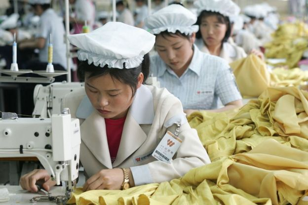 North Korean women work at the assembly line of the factory of South Korean textile company ShinWon at the Kaesong industrial complex on 22 May 2007 in Kaesong, North Korea