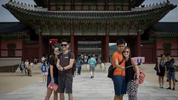 Chinese tourists in front of temple in South Korea