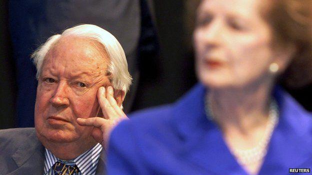 Edward Heath sitting behind Margaret Thatcher