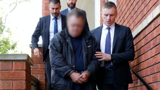 Detectives escort man arrested in Sydney over 1988 murder of US student Scott Johnson