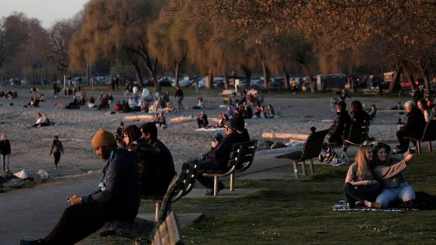 People gather at sunset, during the coronavirus disease (COVID-19) outbreak, at Golden Gardens Park in Seattle, Washington, U.S. March 21, 2020