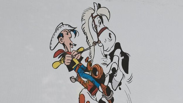 An illustration of cartoon cowboy Lucky Luke on his horse