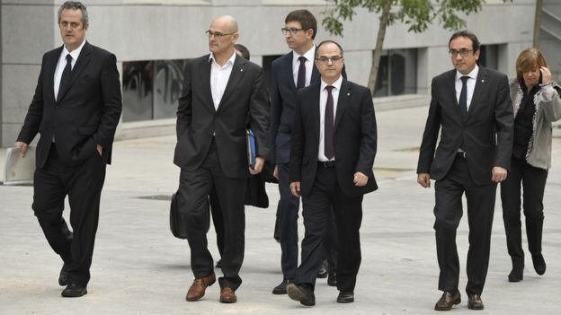 Members of the deposed Catalan regional government arrive at a court in Madrid