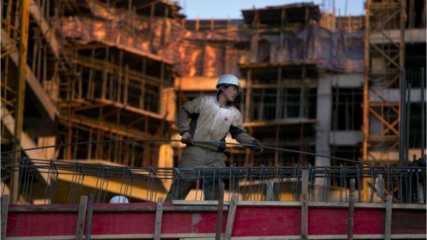 Trabalhador chinês em construção civil