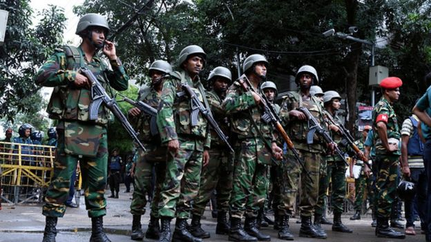 Bangladeshi soldiers stand guard in the capital Dhaka