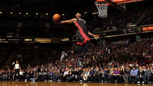 LeBron James about to dunk a basketball