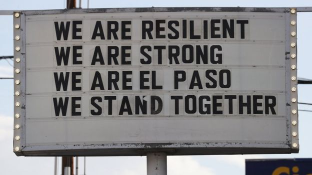 "A sign is posted near the scene of the mass shooting at El Paso, which reads: ""We are resilient, we are strong, we are El Paso, we stand together."""