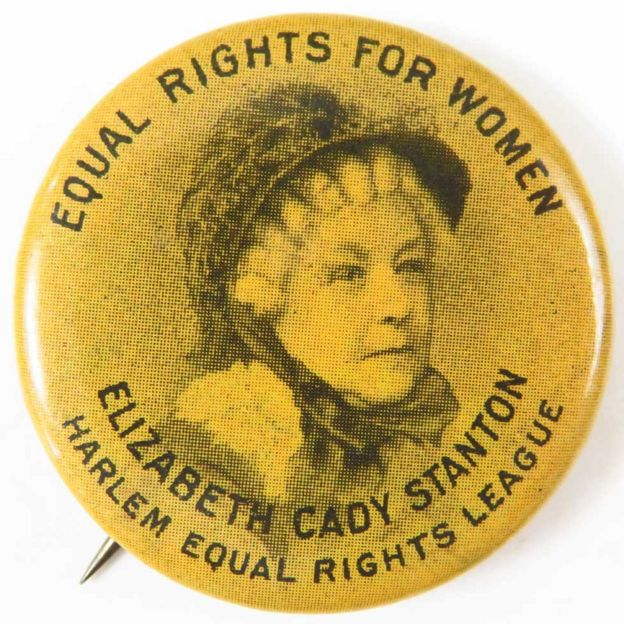 "Black and yellow badge, with a portrait of Elizabeth Cady Stanton, and text reading ""Equal Rights for Women, Harlem Equal Rights League"", 1900"
