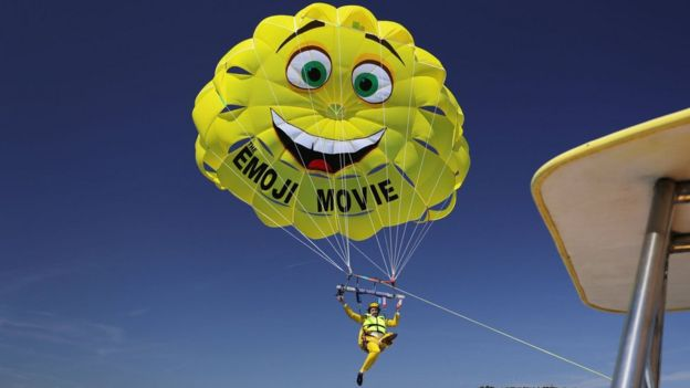 TJ Miller parasails to The Emoji Movie photo call at the start of the Cannes Film Festival