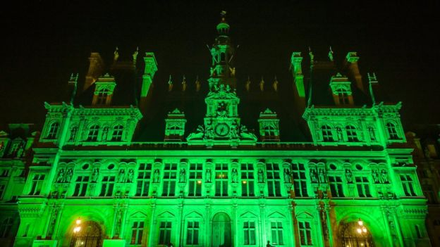 Paris City Hall glowing bright green