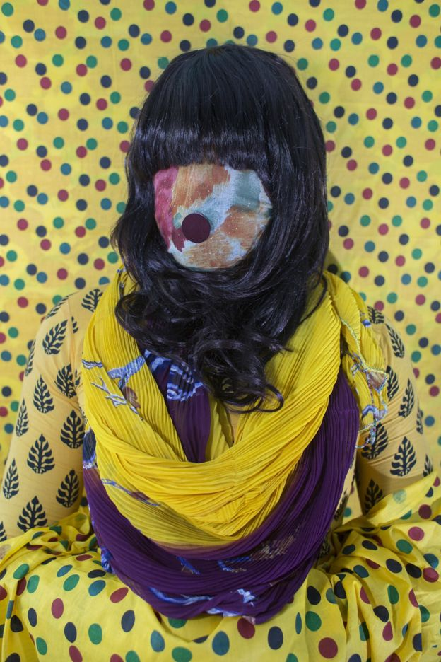 Bangladeshi woman with face covered by fabric