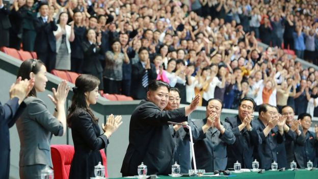 Kim Jong-un (centre) waves to crowds at the opening day of the Mass Games in Pyongyang, North Korea