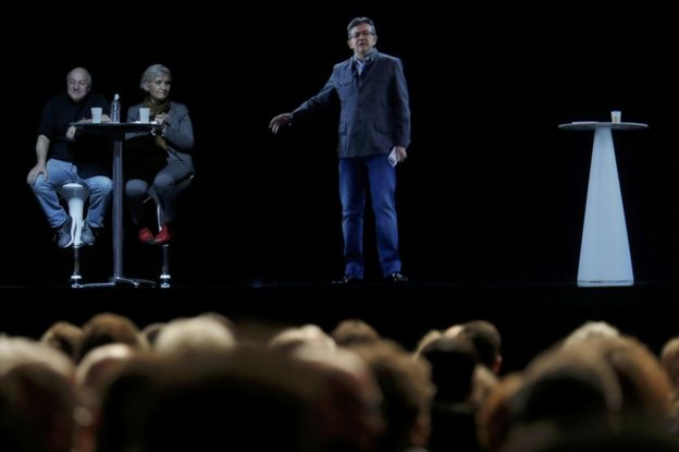 The hologram of Jean-Luc Melenchon speaks to supporters in Saint-Denis, near Paris, 5 February