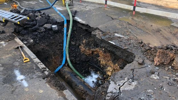 Hole in road at burst main site