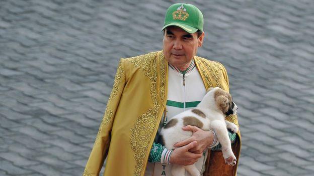 Turkmenistan's President Gurbanguly Berdymukhamedov holds a Turkmen shepherd dog