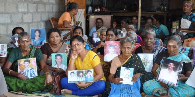 Tamils with photos of their missing relatives