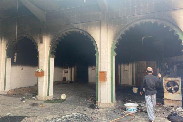 A partially burnt mosque in Delhi's Mustafabad
