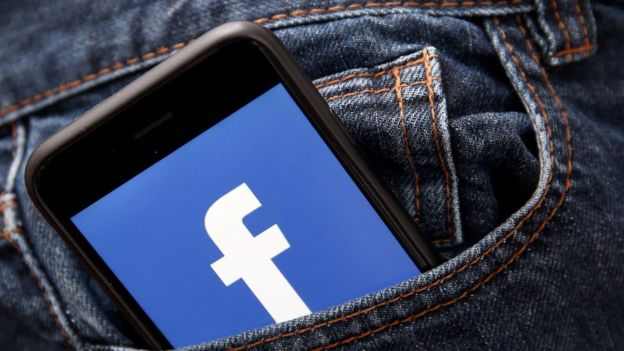 Phone with Facebook logo in pocket