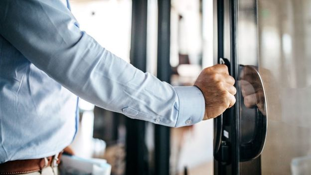 Man with hand on door
