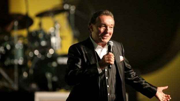 Czech legendary pop singer Karel Gott performs onstage during a concert in Prague, Czech Republic June 11, 2009