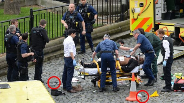 Emergency services at the scene while two knives lay on the floor outside the Palace of Westminster